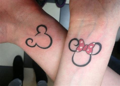 joining tattoos for couples mickey and minnie by electronic on