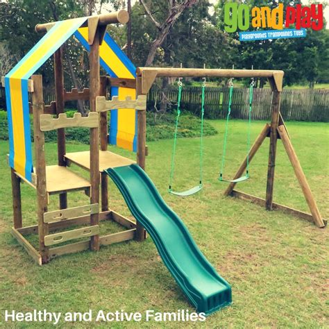 cubby house with slide and swings ozfort play swing slide experience the best go and
