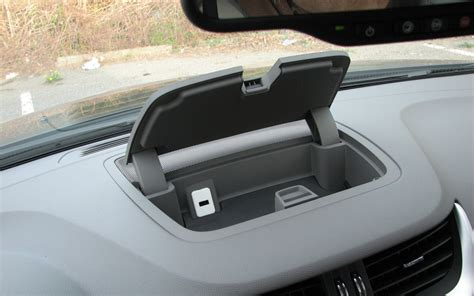 ingenious storage compartment on top of the console it