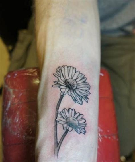white daisy tattoo 23 flowers wrist tattoos