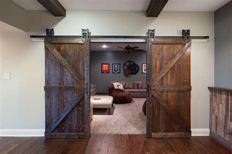 Old World Basement Barn Doors Rustic Basement Indianapolis by Case Design/Remodeling Indy