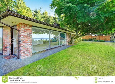 backyard view beautiful brick house with glass walls backyard view