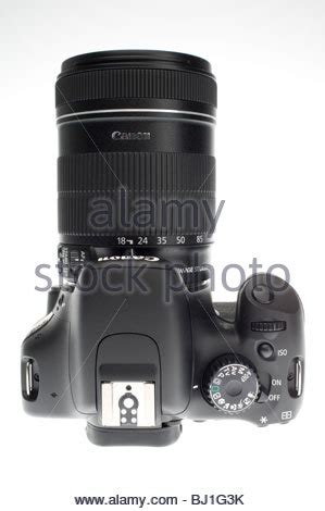 digital slr camera canon eos 500d hd video with zoom lens retouched stock photo, royalty free