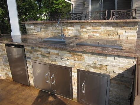 Outdoor Cabinets And Countertops by Outdoor Kitchen With Dual Bar Top Featuring Outdoor Fridge