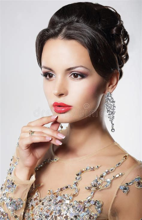 elegant mature woman wearing silver jewelry stock photo elegant woman with evening hairstyle and earrings stock