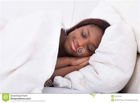 americans in bed african american woman sleeping in bed stock photo image