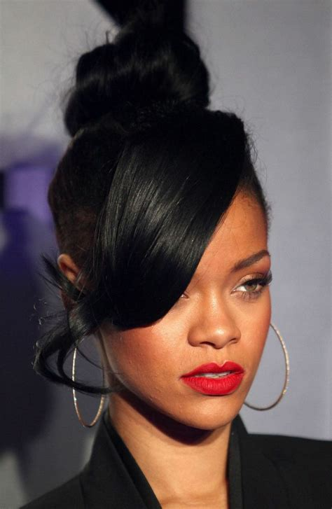 side swoop bangs hairstyle for black wan rihanna top knot with side swept bang hair relaxed
