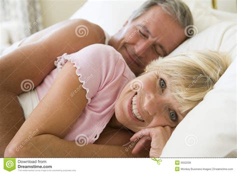 lying in bed couple lying in bed together smiling royalty free stock images image 5552239