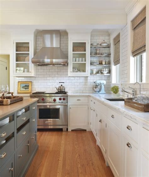 gray and white kitchen white kitchen with gray island content in a cottage