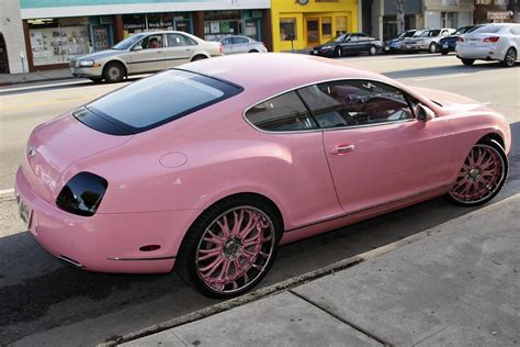 pink bentley convertible in out shopping with