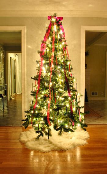 how to tie ribbon around a christmas tree bow for top of trees happy holidays