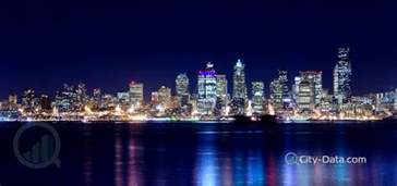 seattle city lights up the sky