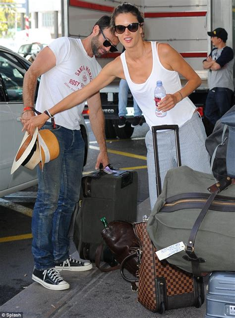 comfortable pants for long flight alessandra ambrosio cuddles fiance jamie mazur as they
