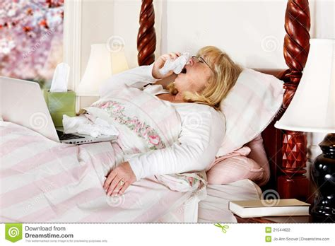 working in bed woman working sick stock photography image 21544822