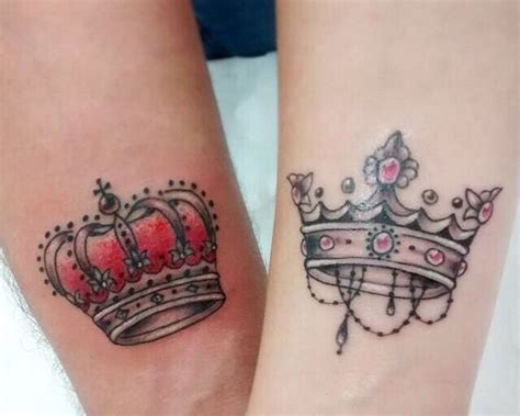 beautiful couple tattoos black king crown on back models picture