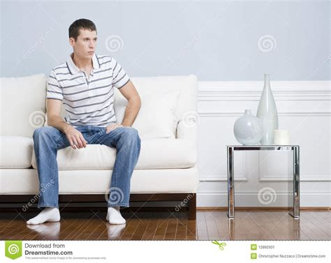 couch sitting man sitting on living room couch stock image image 12892931