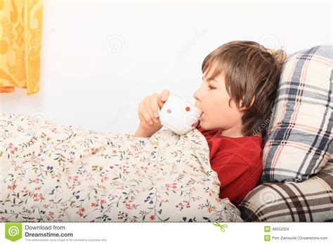 girl lying bed with flowers sick boy