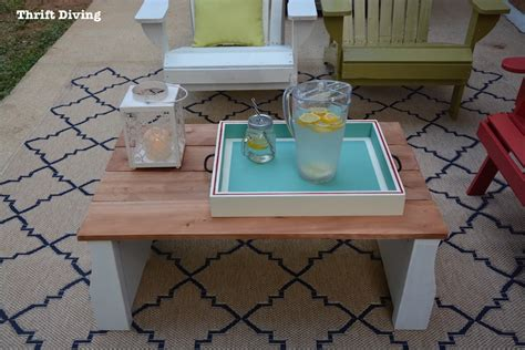 how to make a coffee table into an ottoman i upcycled my son s old crib into a coffee table for my patio
