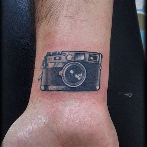 camera wrist tattoo designs ideas and meaning tattoos for you