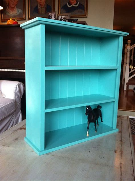 bookshelves turquoise and on
