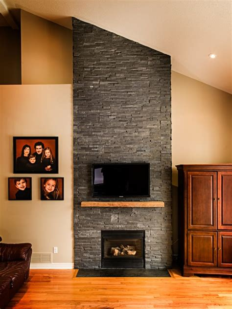 dark stone veneer fireplace  wood mantel traditional