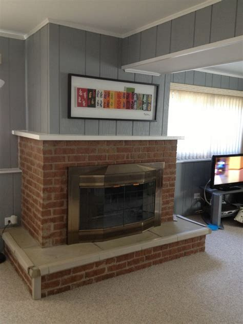 How To Update A Fireplace by How To Update This Dated Brick Fireplace