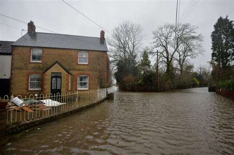 haircut somerset calgary gallery flooding cuts off some villages in england for weeks