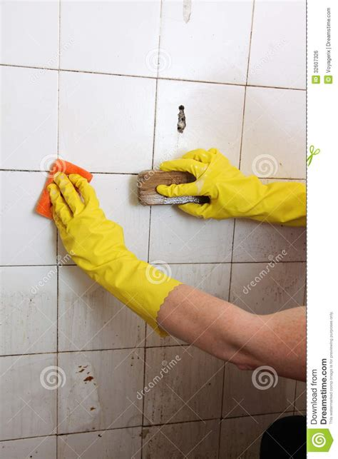 cleaning old tile floors bathroom cleaning of dirty old tiles in a bathroom royalty free