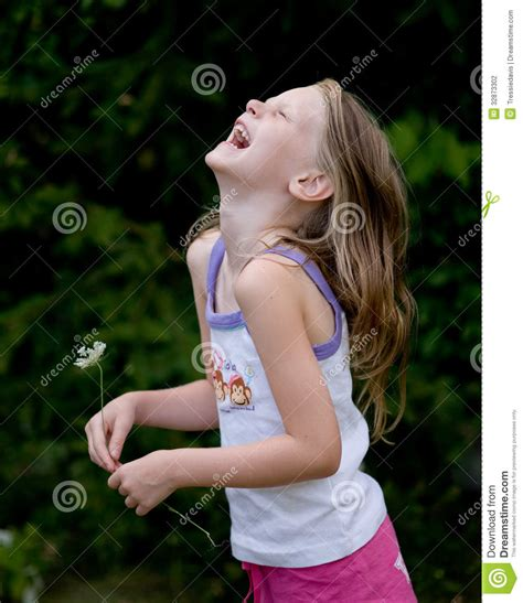 little girl up shorts little girl laughing with flower stock photography image