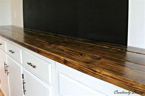 diy rustic wood countertops torched diy rustic wood counter top for 50 by creatively living