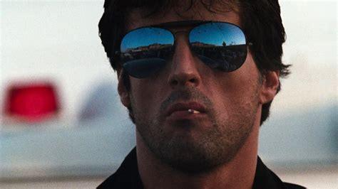 film rambo cobra the adam carolla show analyzes the 1986 sylvester stallone