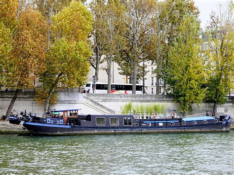 boats on the seine boat on the seine river in paris france photograph by