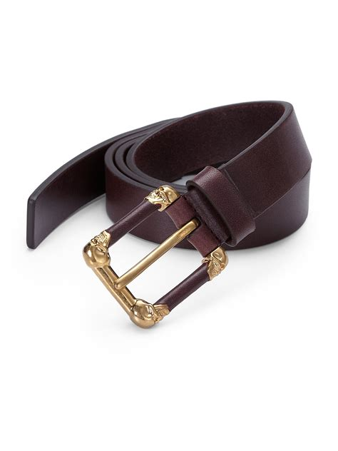 mcqueen four skull buckle leather belt in brown