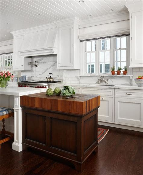 white kitchen island with butcher block top cottage kitchen