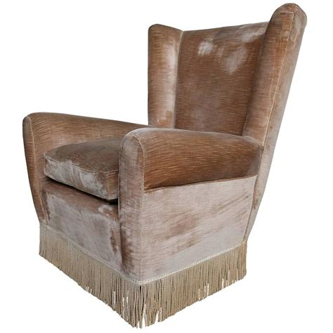 cozy armchair cozy wingback armchair in the style of paolo buffa from