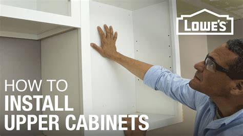 how to hang a kitchen cabinet how to hang cabinets youtube