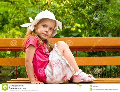 on the bench little girl sitting on the bench stock photography image 19874202