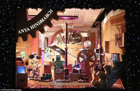 christmas house window displays a flying carpet and a giant gingerbread house london s department stores show off