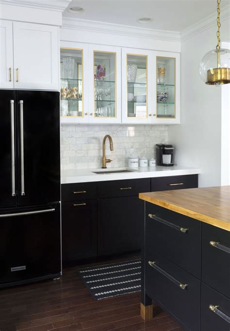 Black And White Kitchen Cabinets by Black Refrigerator With Black Base Cabinets And White