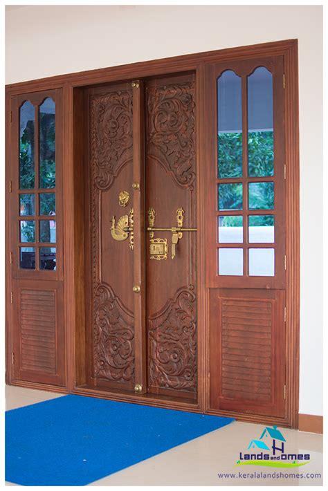 front door designs kerala stylereal estate kerala