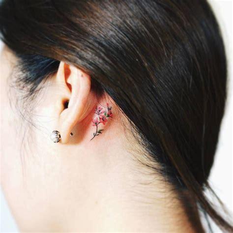 small flower tattoos behind ear tiny flower the left ear artista tatuador
