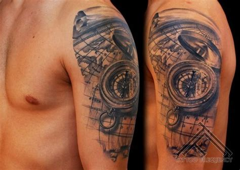 tattoo 3d mapping black and grey 3d compass with map tattoo on man left