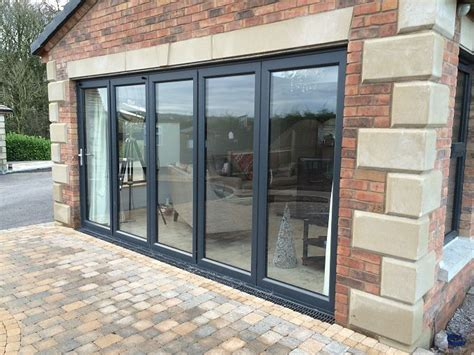Bi Fold Patio Doors Aluminum Aluminium Framed Doors The Framing Is Grey Ral 7016 Which Contrasts Against The Brick Work
