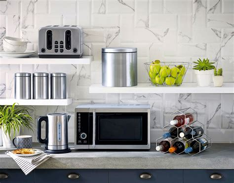 can you put a countertop microwave in a cabinet 9 places to put the microwave in your kitchen lifedesign