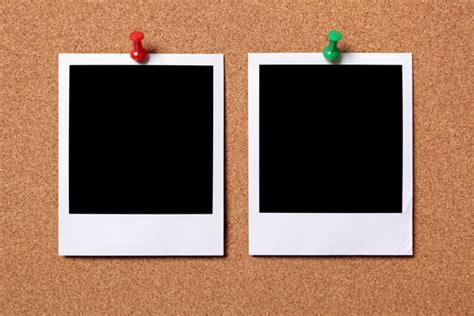 two polaroid photo prints on a cork notice board photo