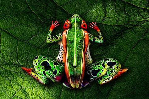 human painting artist paints human to camouflage into