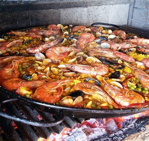 come si cucina la paella di pesce paella di pesce spagnola originale la ricetta della