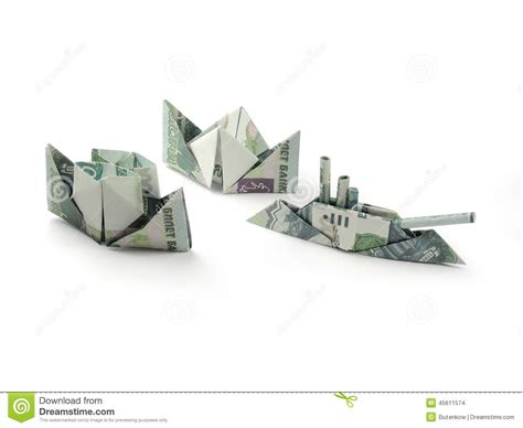 Ship Origami - origami ships of one thousand ruble banknotes stock photo