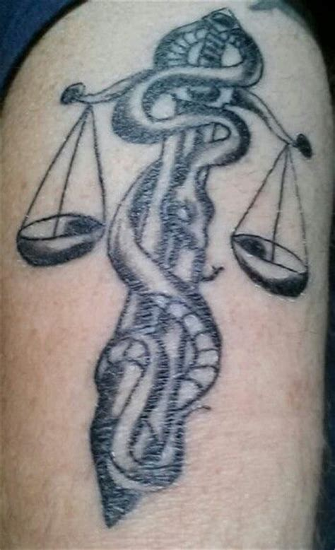 snake scales tattoo designs scales of justice with snake wrapped around sword