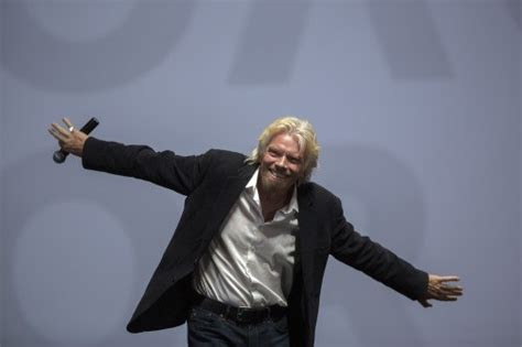 branson aims mid 2018 space trip as resumes powered tests moneyweb